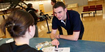 Student receives help and advice from student adviser.