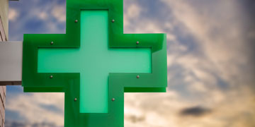 the green cross pharmacy sign