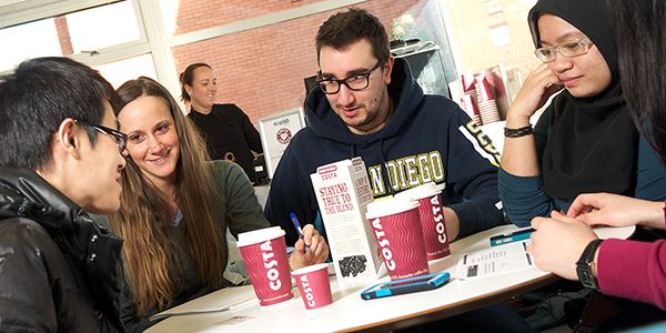 Students enjoy coffee in Aroma, Lord Todd.