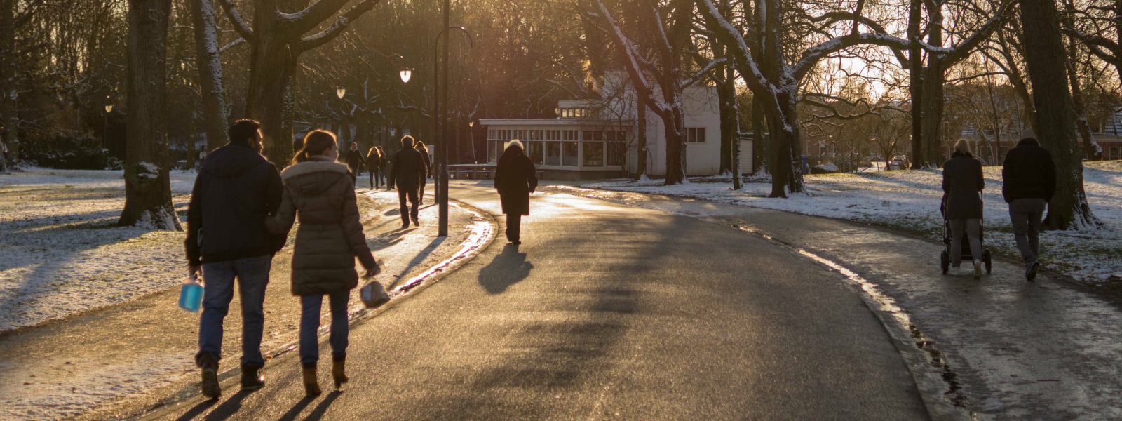 People walk in a park during winter