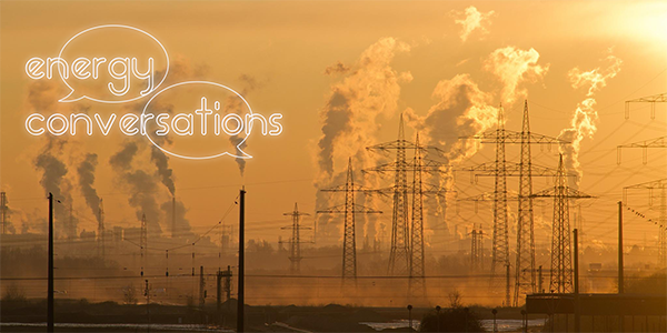Smoking industrial towers with Energy Conversations logo