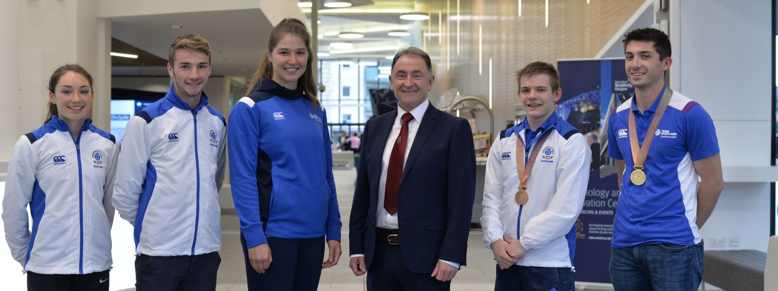Commonwealth Games student athletes Holly McArthur, Rob Harwood, Bethan Goodwin, David Weir and David McMath with Principal & Vice-Chancellor Professor Sir Jim McDonald.