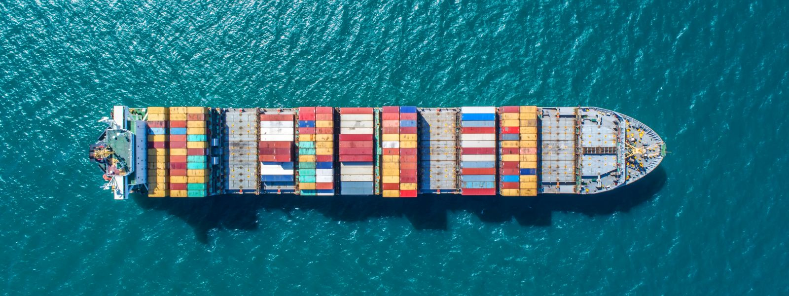 Container ship with colourful shipping containers viewed from above