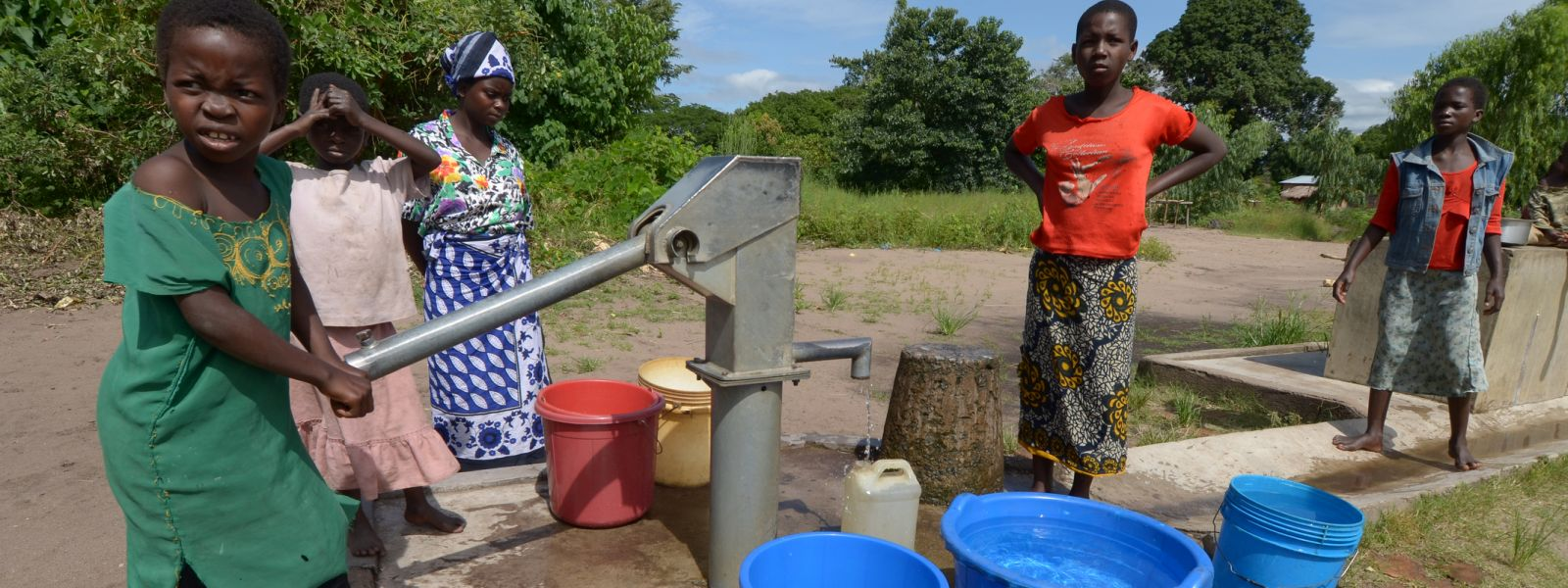 Children operate a water pump in Malawi