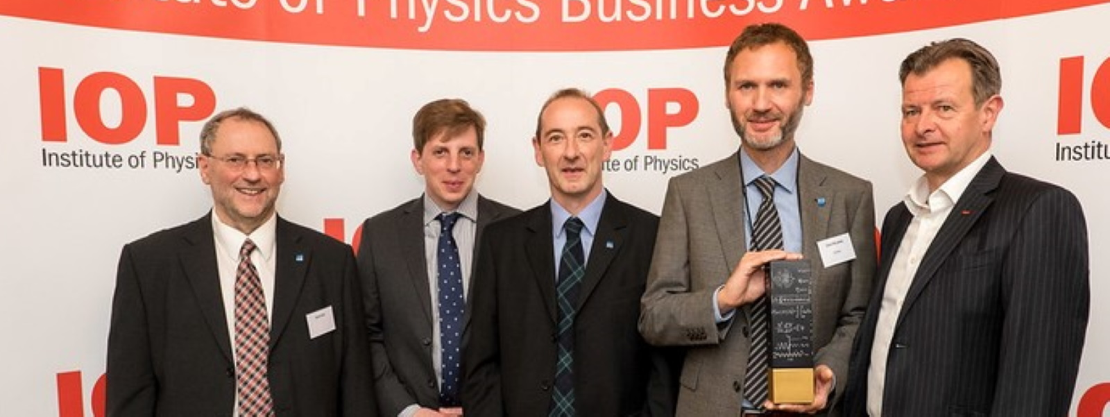 Left to right: Professor David Birch (HORIBA and University of Strathclyde); Richard Hirsch (HORIBA); Dr Graham Hungerford (HORIBA), Dr David McLoskey (HORIBA) and Dr James McKenzie (Vice-President Business, Institute of Physics). Photo by Institute of Physics.