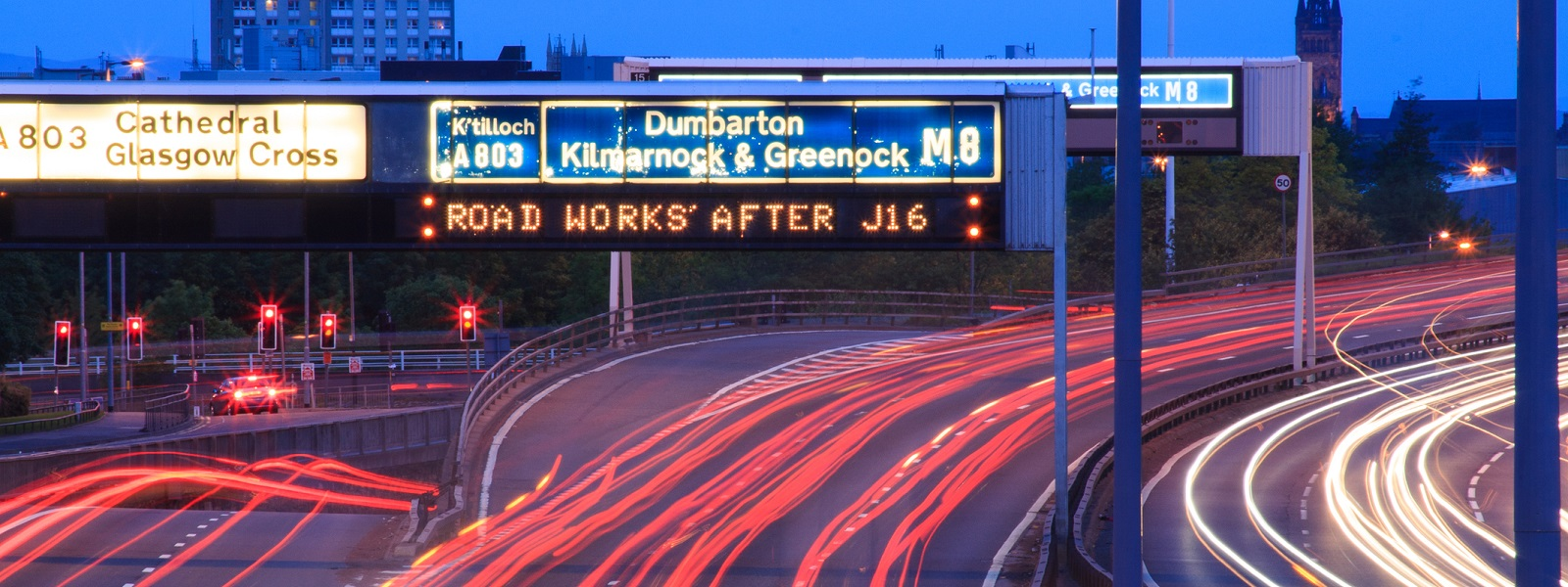 M8 Motorway at dusk showing trails of rear car lights