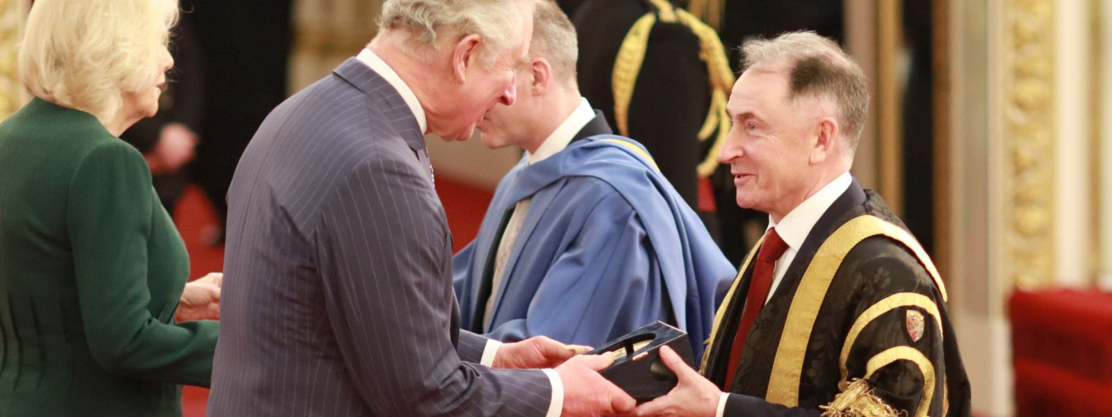 HRH The Prince of Wales presents Professor Sir Jim McDonald with the Queen's Anniversary Prize.