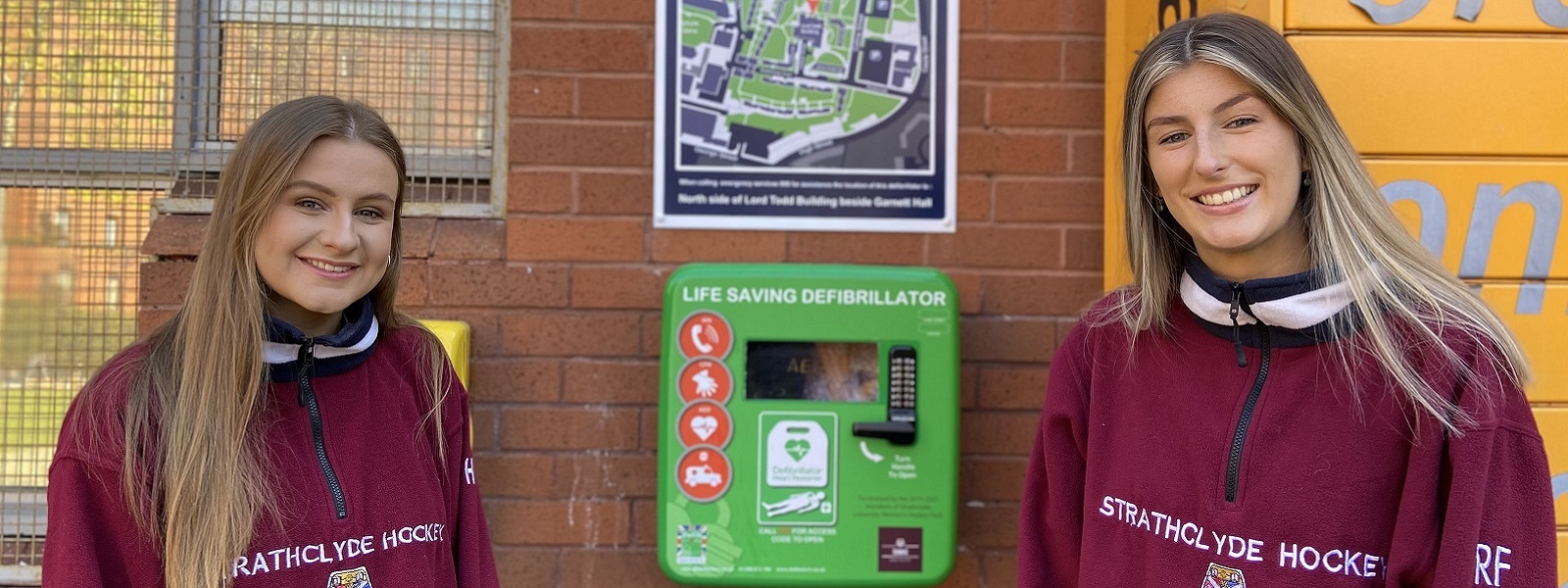 Students Helena Tipper and Rebecca Flett with the new AED.