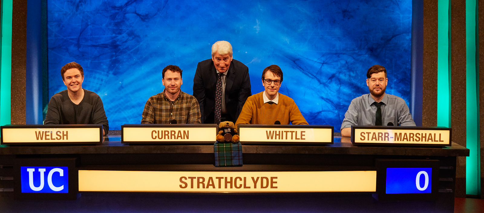 Strathclyde's University Challenge team with host Jeremy Paxman at their first round match