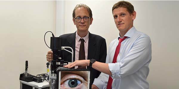 Dr Mario Giardini & Dr Iain Livingstone with a slit lamp used in virtual