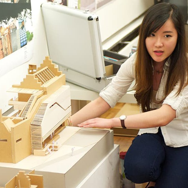 Female student with architecture model