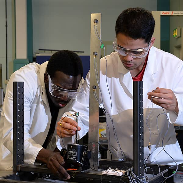 Two students working on a project in the Department of Mechanical & Aerospace Engineering.