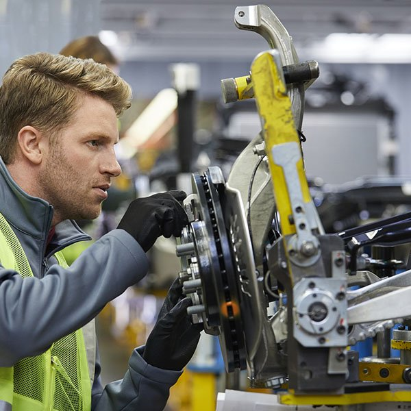 Male engineering working in automobile industry