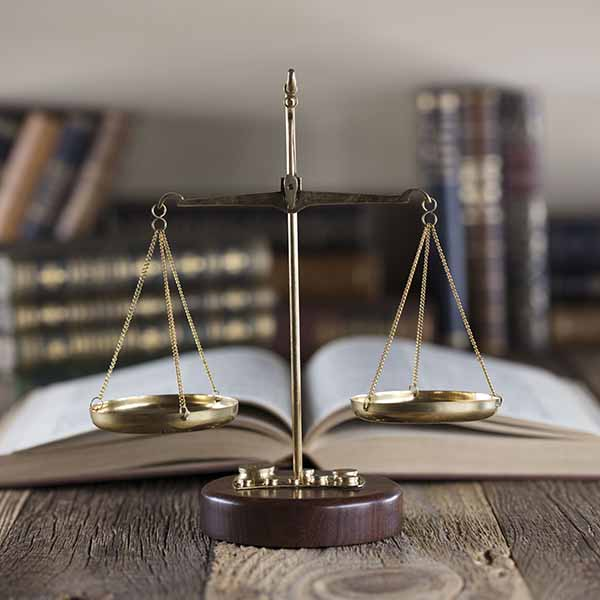 Law scales with open book
