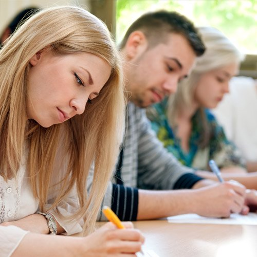 Three students in a lecture