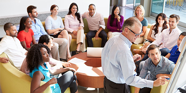 Businessman giving presentation to employees