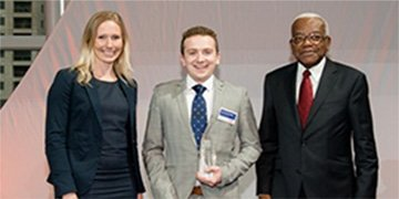 Undergraduate Scottish student of the year, Jamie Cooper- Higgins, with Alexandra Hopkins and Sir Trevor McDonald