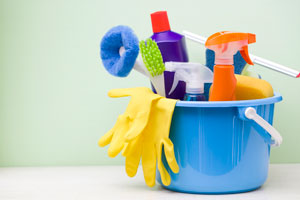 a bucket full of cleaning supplies