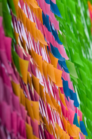 post it notes all over a wall
