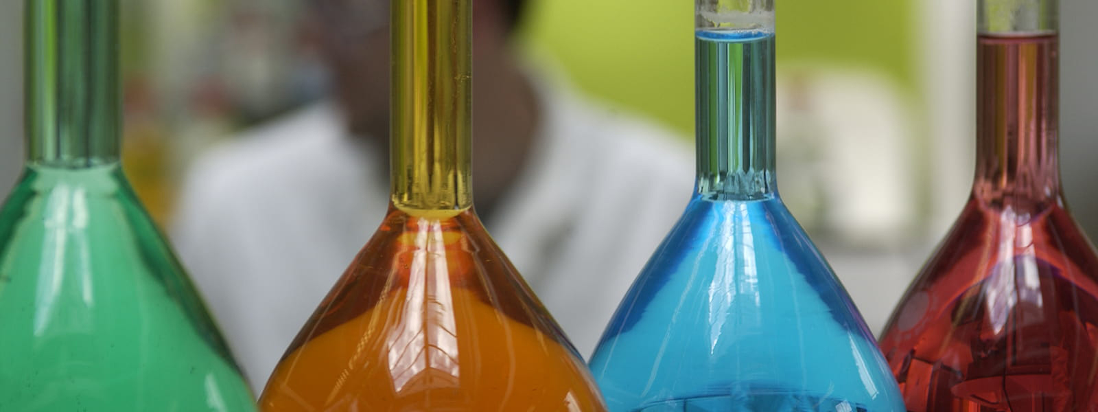 Coloured liquid in beakers