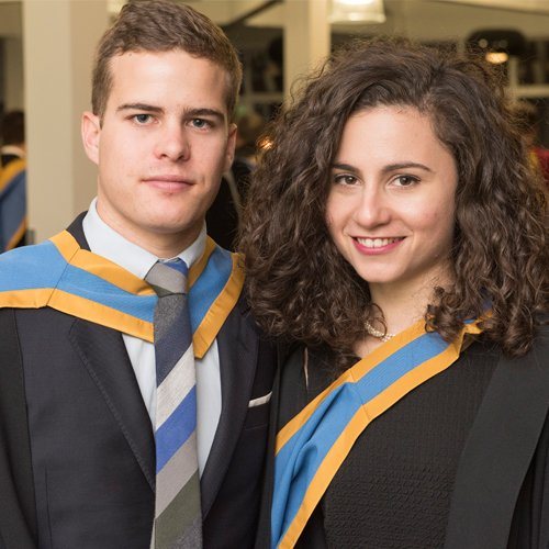 Male and female student at graduation
