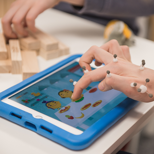 hand w/ motion sensors on an ipad