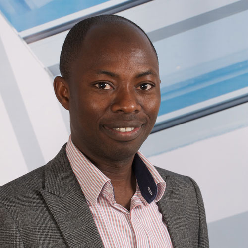 Education lecturer Edward Sosu smiling at the camera for a corporate staff photograph