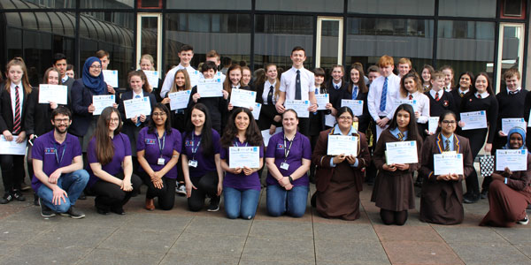 Young Chemical Ambassadors programme participants hold their certificates and smile at the camera