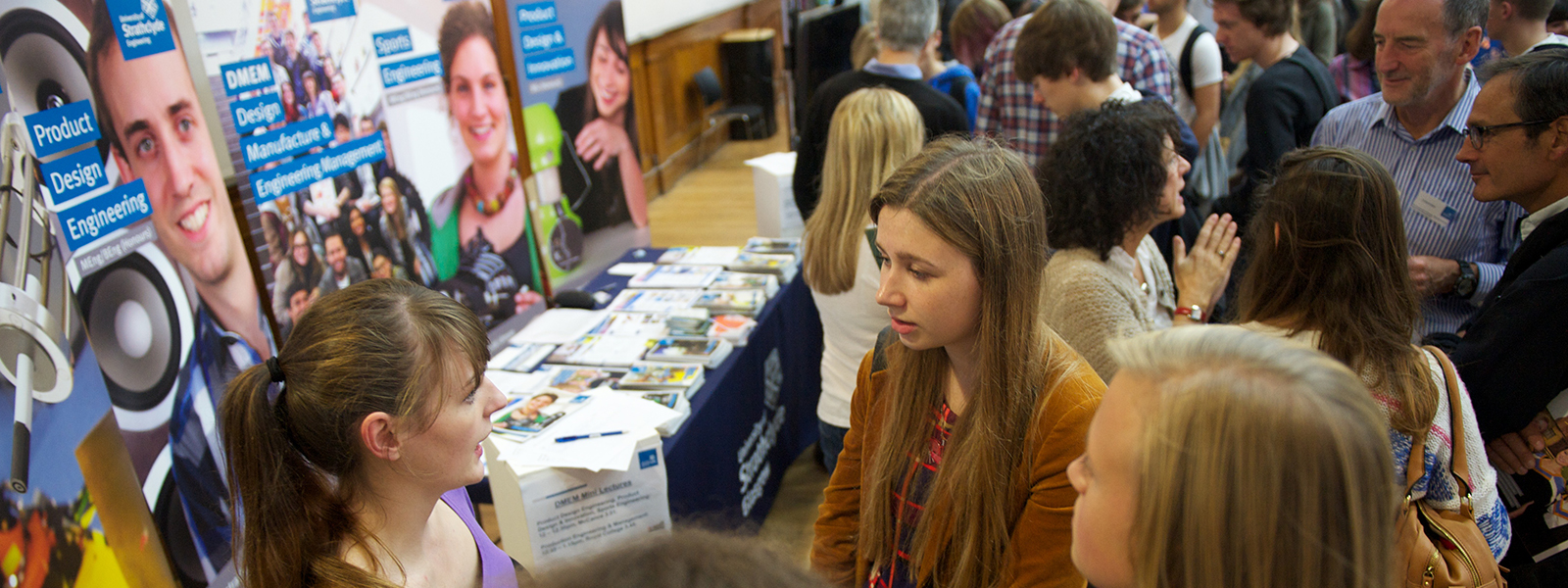 young people speaking to adviser at university open day