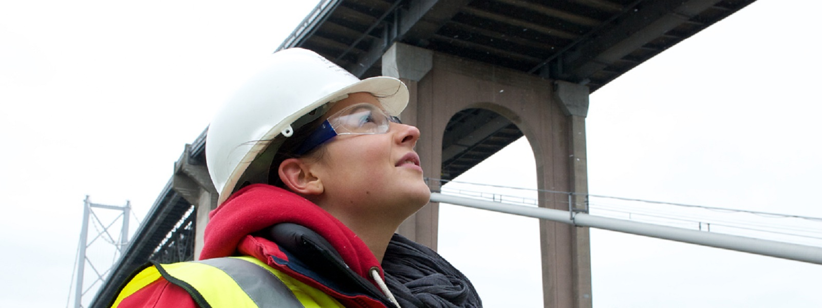 civil engineering student looking at bridge