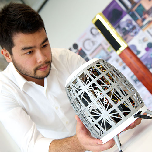Design, Manufacture & Engineering Management student examining a project