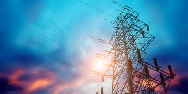 Energy Pylon from below, looking up, against a blue and pink sky