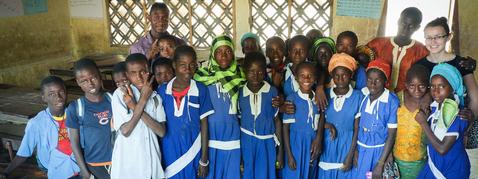 Strathclyde students posing with a group of pupils from a school in Gambia