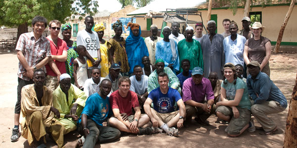 Electronic & Electrical Engineering students posing for a group shot with a community in Gambia