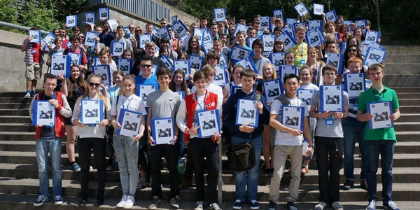 2014's Space School cohort standing on the stairs in rottenrow gardens with their space school booklets