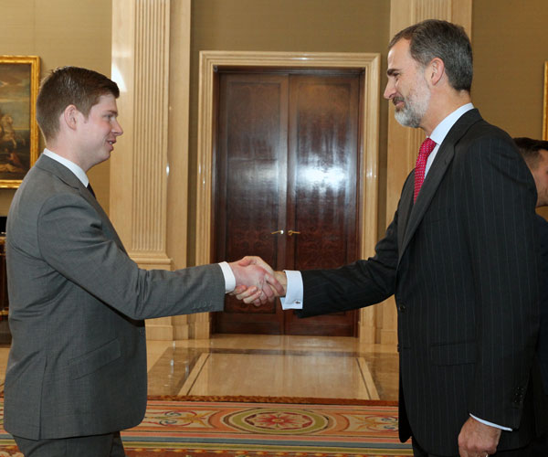 Andrew Sweeny meeting the King of Spain, shaking hands in the Royal Palace