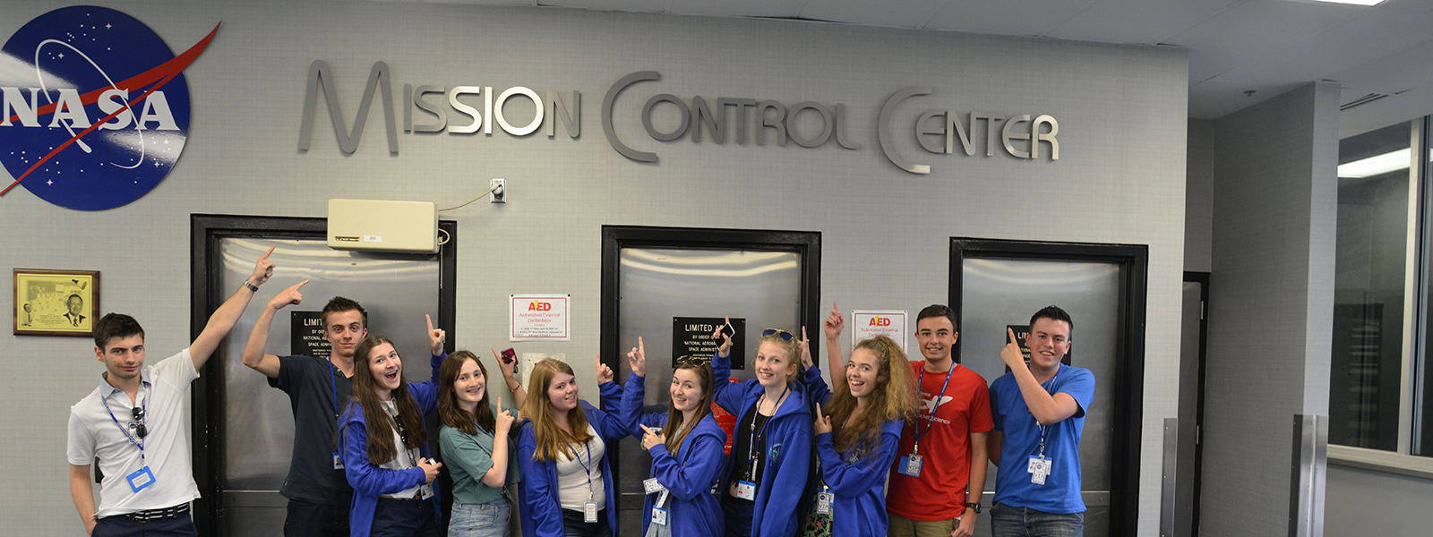 Pupils pointing to the NASA Mission Control Center sign