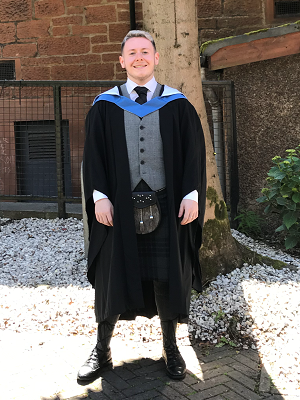 Lewis Creechan in his graduation gown