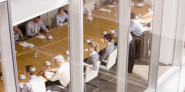 View of business people sitting in conference room.
