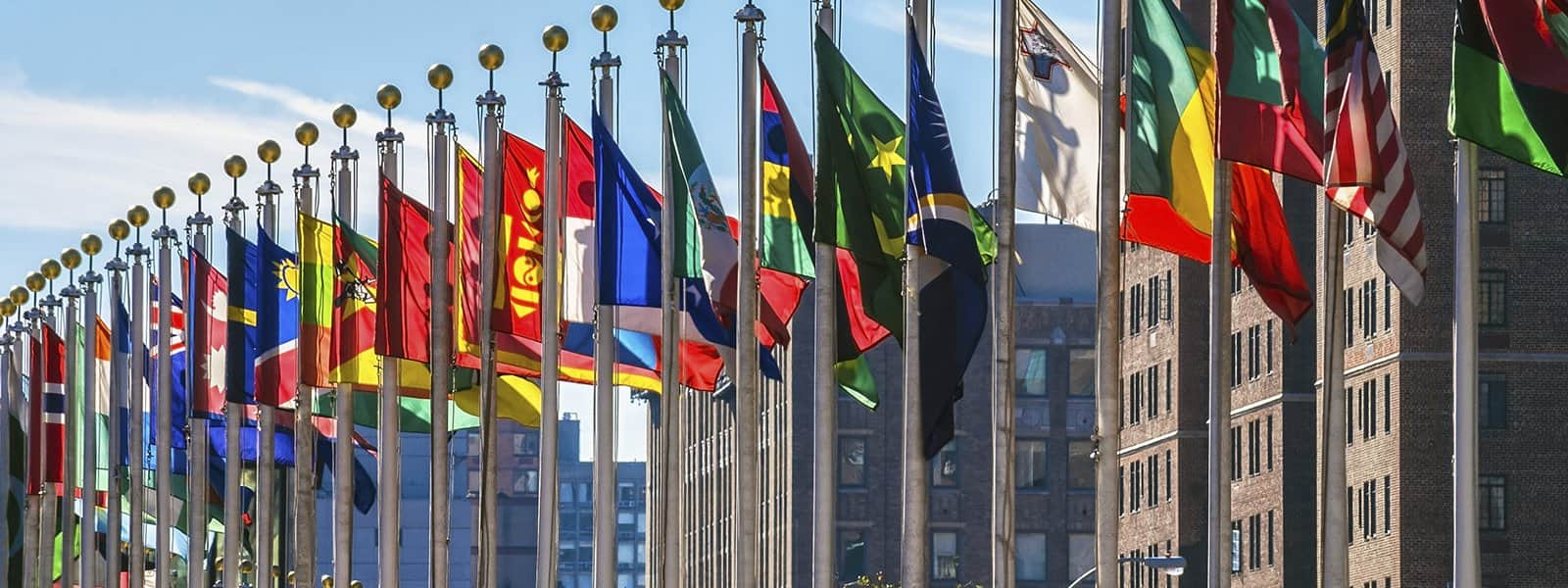 Flags outside the United Nations headquarters in New York, USA