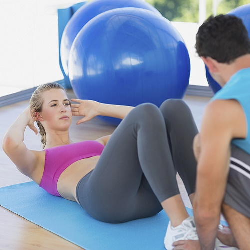 Man in woman in personal training session