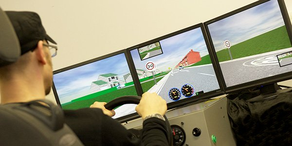 Male using driving simulator facility