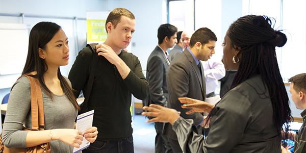 Postgraduate students at a career fair