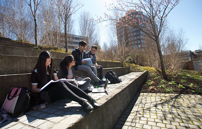 Students studying in Rottenrow Gardens in Spring