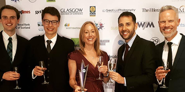 Conference and events and sustainability team with Glasgow Business Award