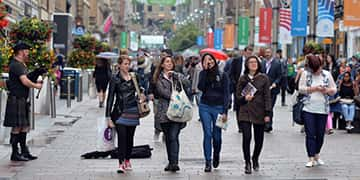 University of Strathclyde students walk down Buchanan Street in the city centre of Glasgow.