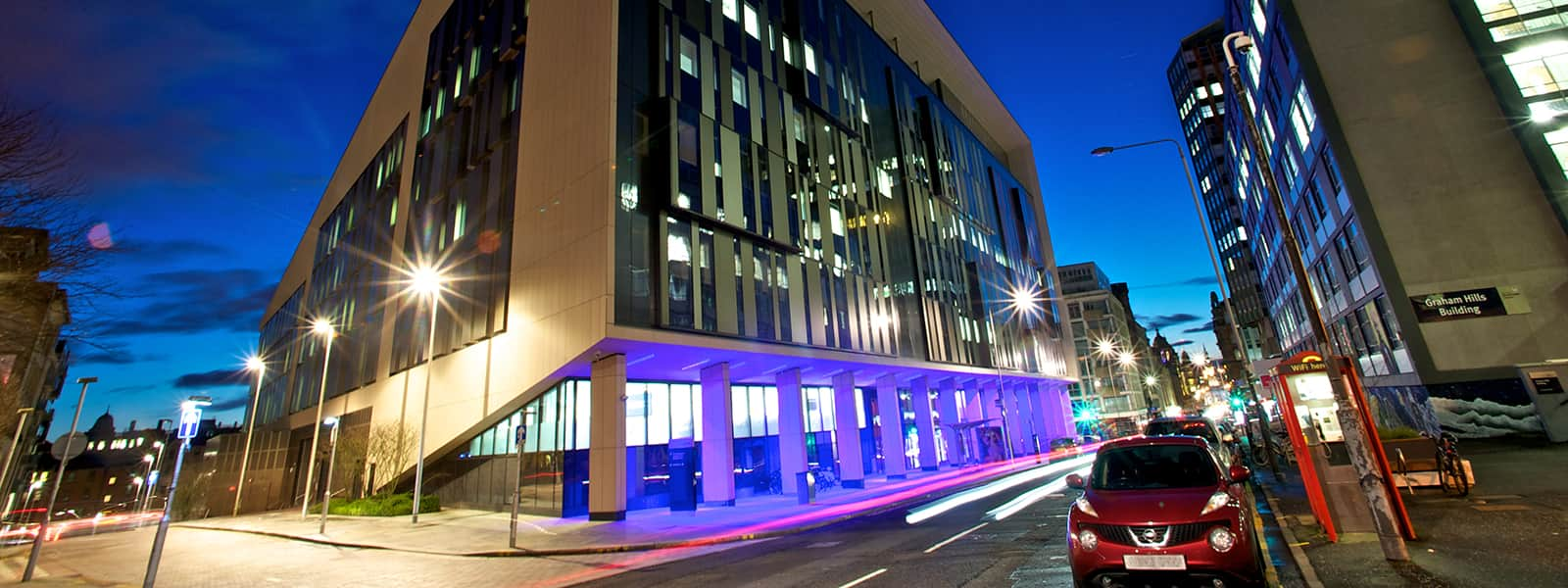 Artistic shot of the Technology & Innovation Centre lit up at night