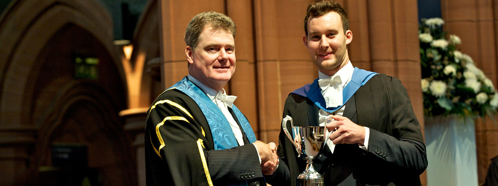 Craig Taylor being presented with the 2014 Strathclyde People Award trophy