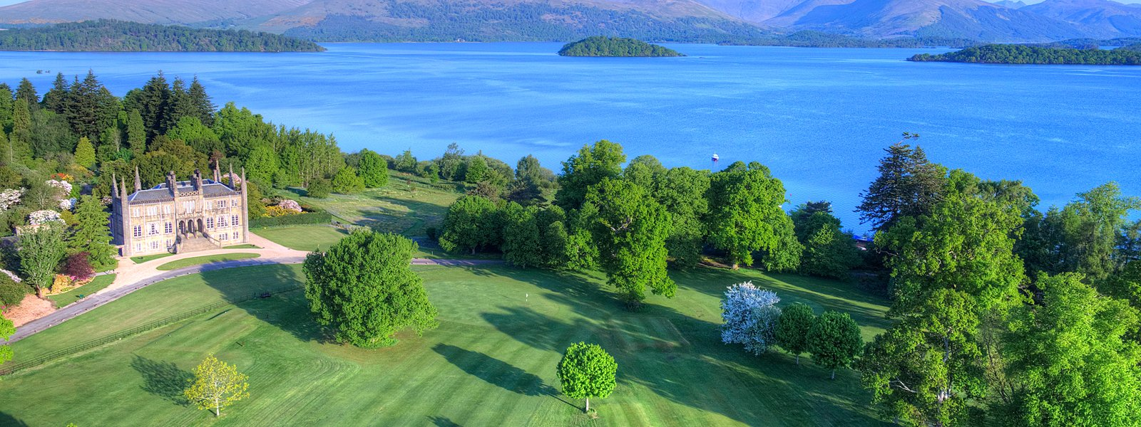Aerial shot of Ross Priory and grounds, including Loch Lomond. Image courtesy of Aye in the Sky Aerial Photography