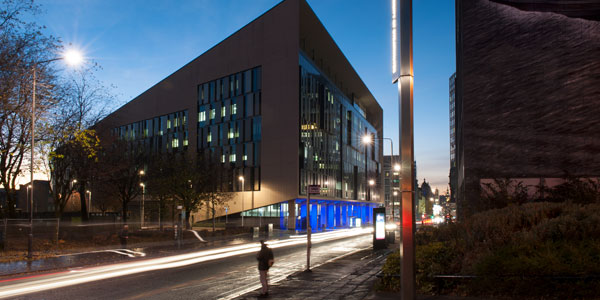 a long exposure shot of the technology and innovation centre at dusk, with lights streaming through george street
